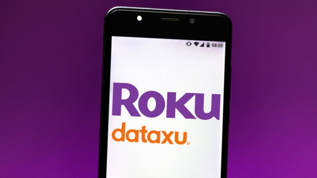a phone displaying the roku and dataxu logos