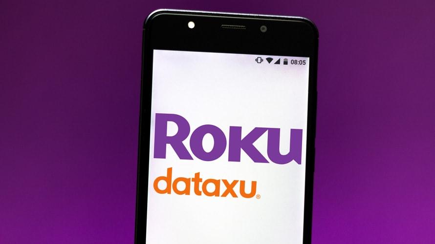 a phone displaying the roku and dataxu logos
