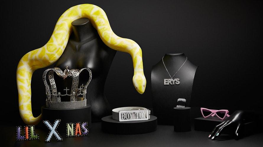 group photo of musical props from Spotify's pop-up including Madonna's boy toy belt, Billie Eilish's crown, Lil Nas X's jacket patch, etc.
