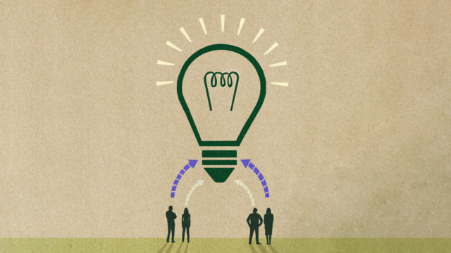 A lightbulb on top of four people with arrows pointing to the lightbulb