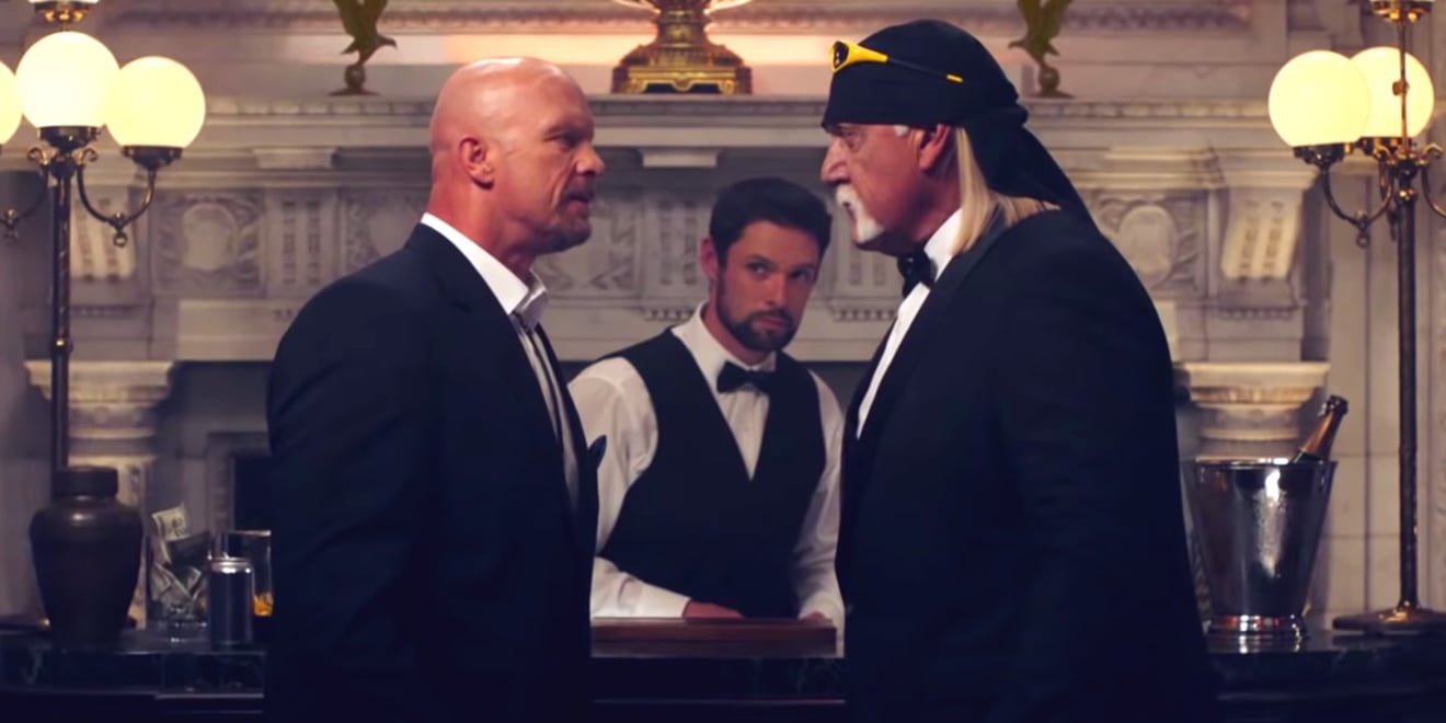 Stone Cold Steve Austin and Hulk Hogan stare at each other in ad for video game WWE 2K20.