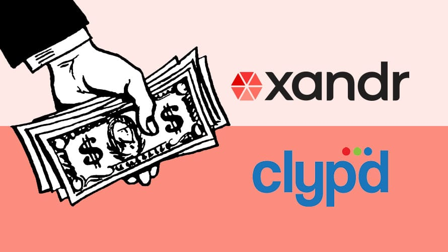 a hand holding money with the xandr and clypd logos