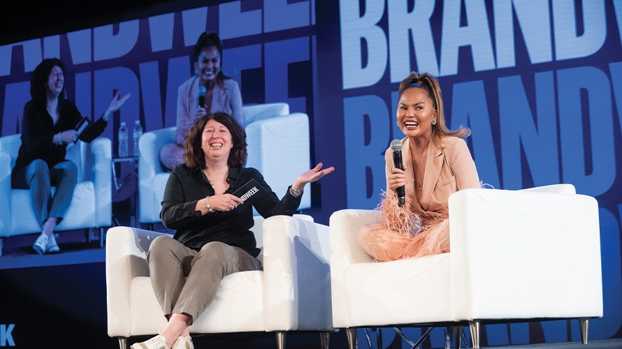 Adweek's Lisa Granatstein, editor, svp programming, smiles with Chrissy Teigen, cookbook author, television personality, model.