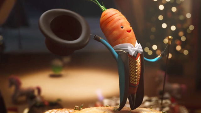 A carrot dressed as a circus announcer holds out a top hat