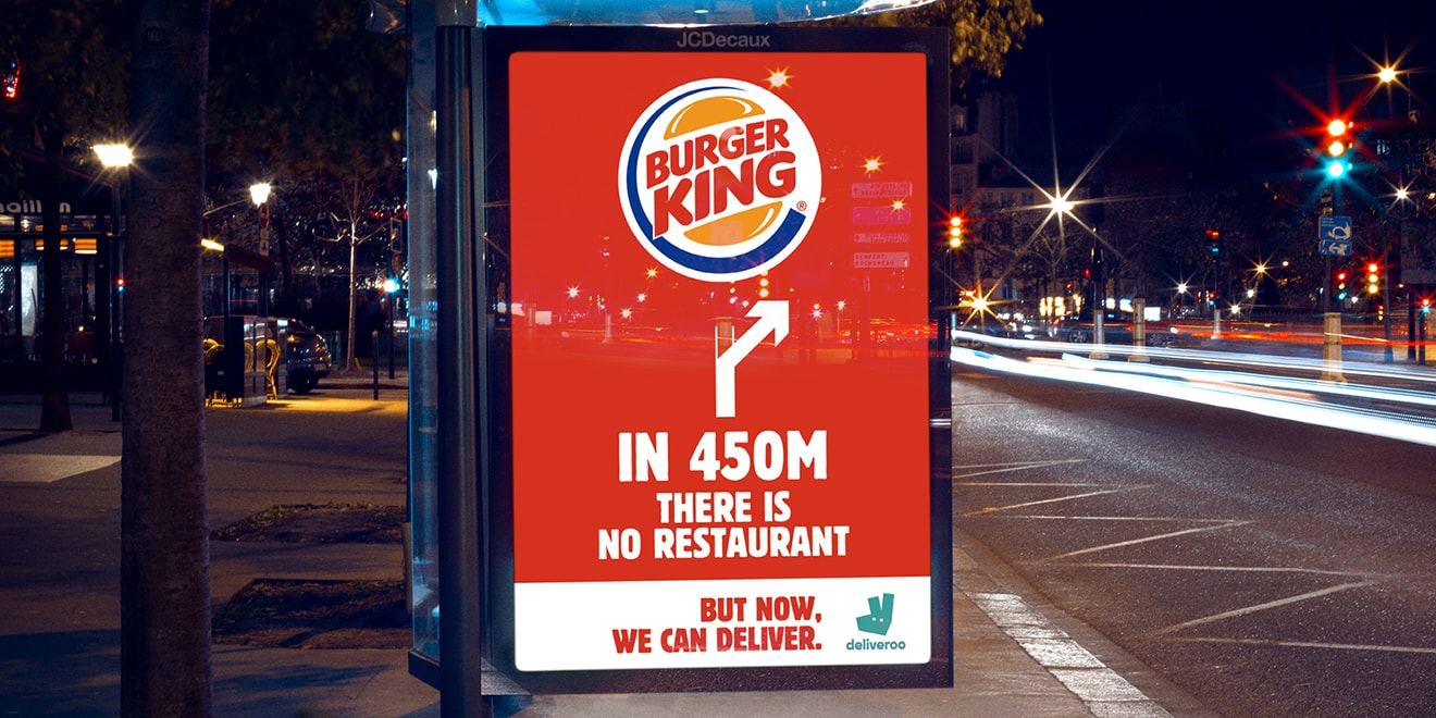 A Burger King outdoor ad says that in 450 meters there is no restaurant