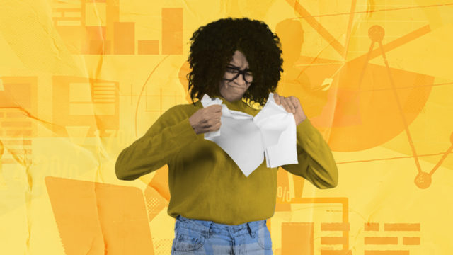 Woman ripping paper on a yellow background with graphs, and sketches