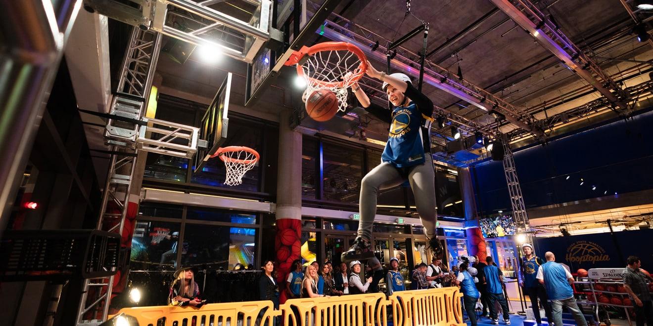 a person making a basketball dunk at hooptopia
