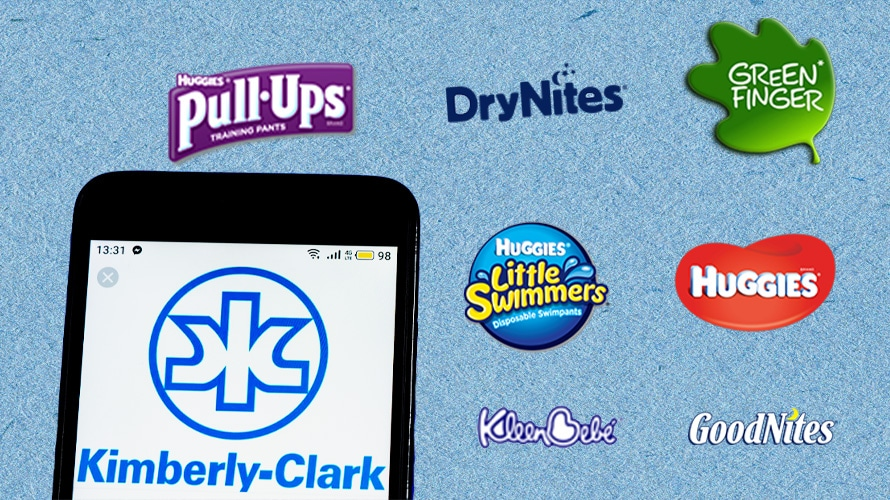 Kimberly-Clark logo in phone screen surrounded by Kimberly-Clark baby and childcare brand logos