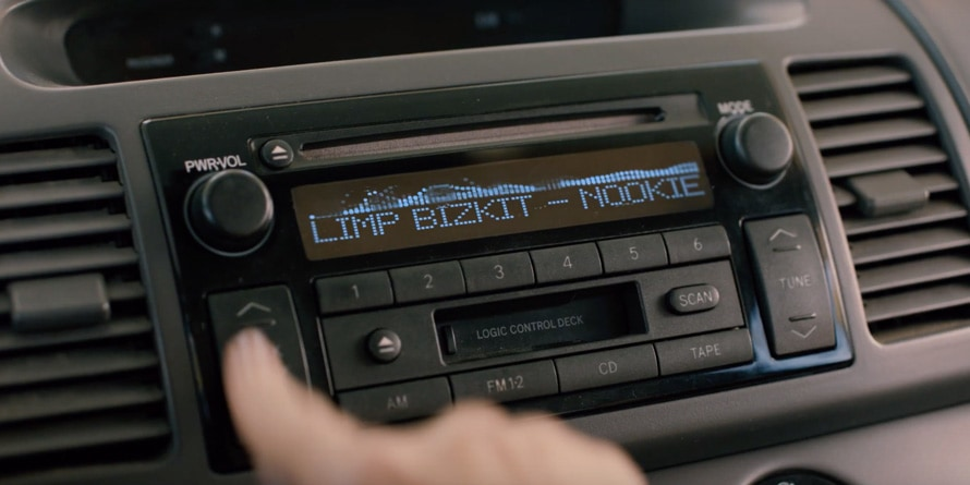 Stuck car cd player playing Limp Bizkit's Nookie with blurred hands trying to change the music