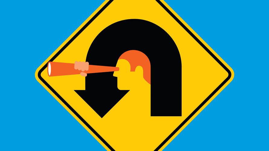 street sign with man looking through a microscope