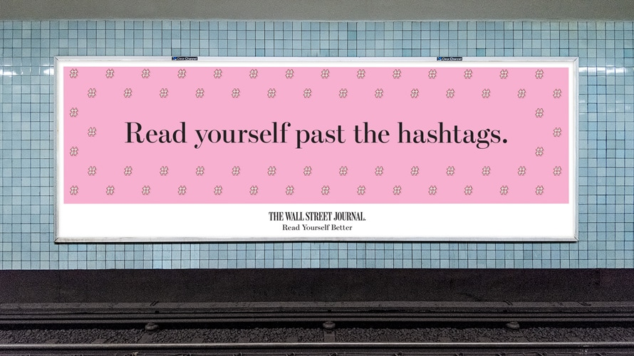 "a billboard that reads ""read yourself past the hashtags"""