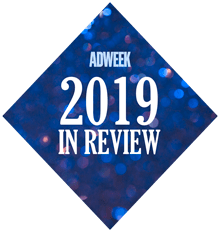 says adweek 2019 in review in a blue sparkly diamond