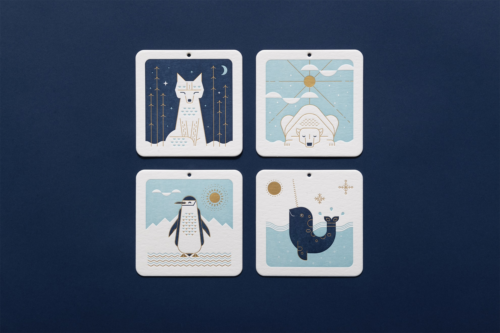 Typically cold-weather creatures on coasters that double as ornaments: fox, polar bear, penguin and narwhal