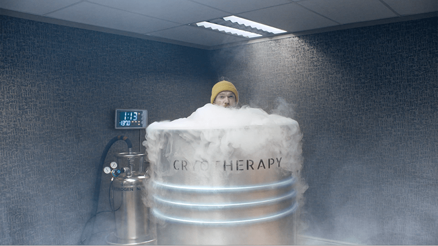 a person standing in a big bubbly tub
