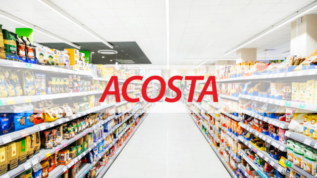 "A supermarket aisle with text that says ""Acosta"" in the center"