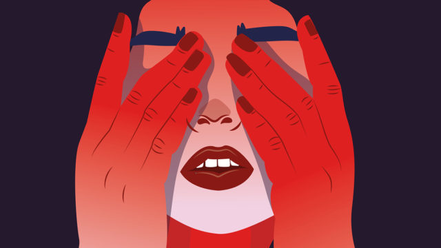 a woman's face in red covering her eyes