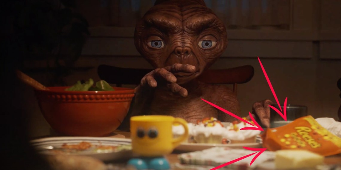 A still of E.T. with two arrows pointed at Reese's Pieces.