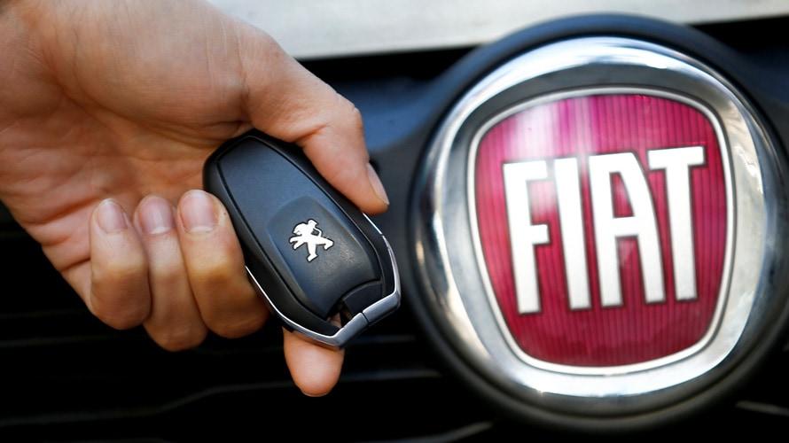 Peugeot key remote and Fiat emblem