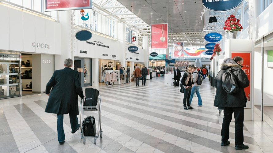 People shopping in airport terminal