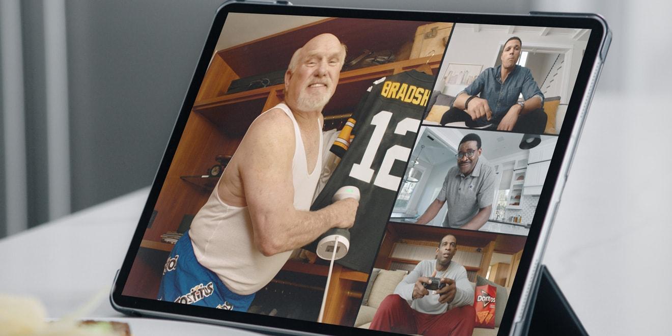 Terry Bradshaw, Tony Gonzalez, Michael Irvin and Deion Sanders on a tablet screen