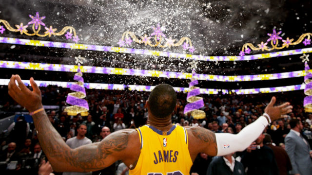 Back of Lebron James spreading his arms out in the air