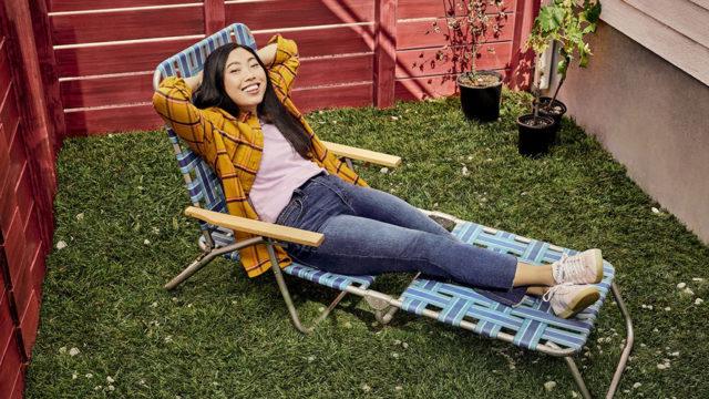 awkwafina in a pool lounge chair