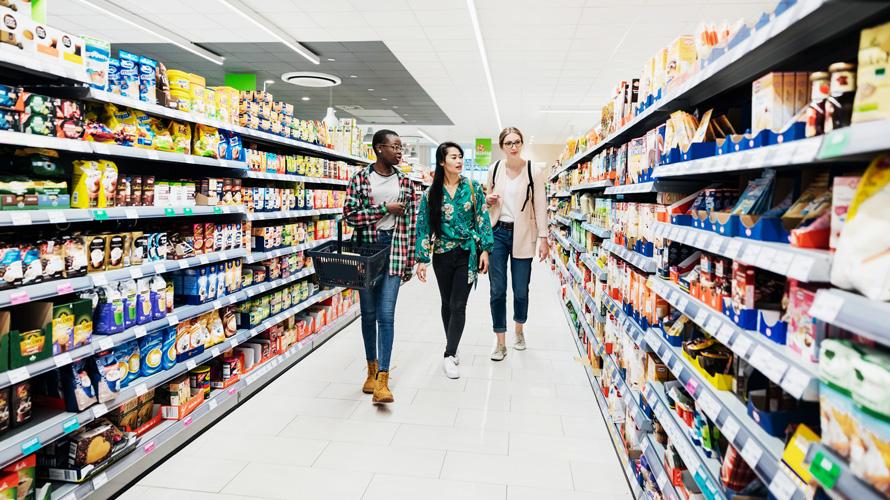 Shoppers walking down aisle