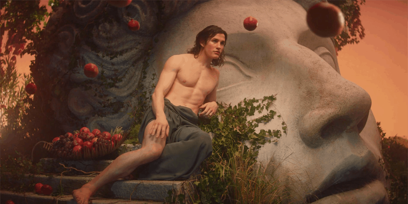 Narcissus sitting on steps next to grapes and apples