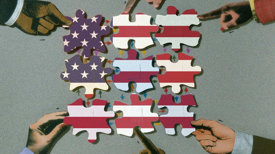 puzzle pieces fitting together to form an american flag