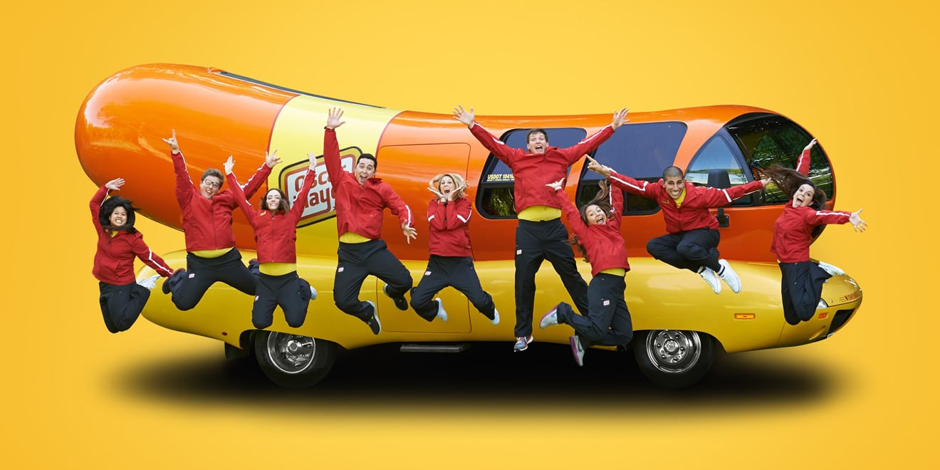 Oscar Mayer Wienermobile and people jumping