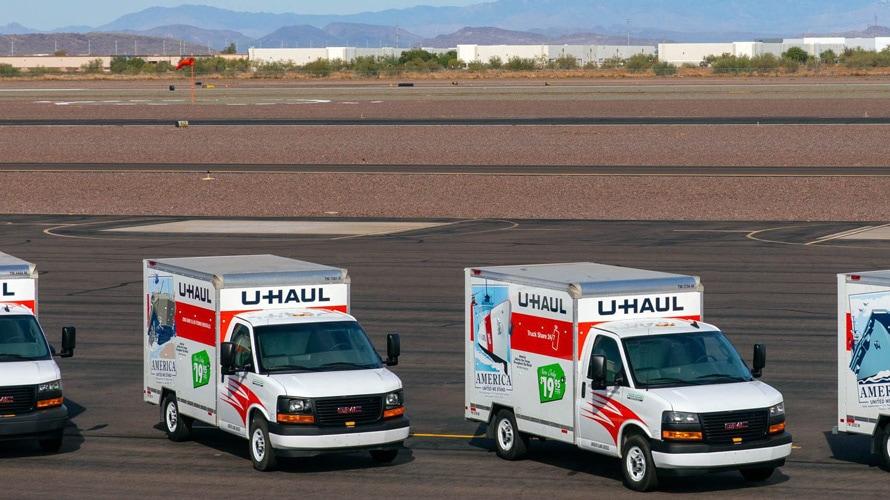 a line of u-haul trucks