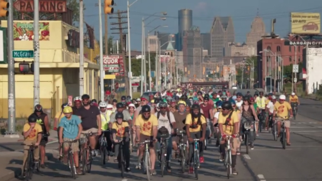 A bicycle rally rides through Detroit.