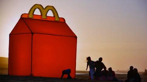 kids gather to worship giant mcdonald s happy meal box adweek