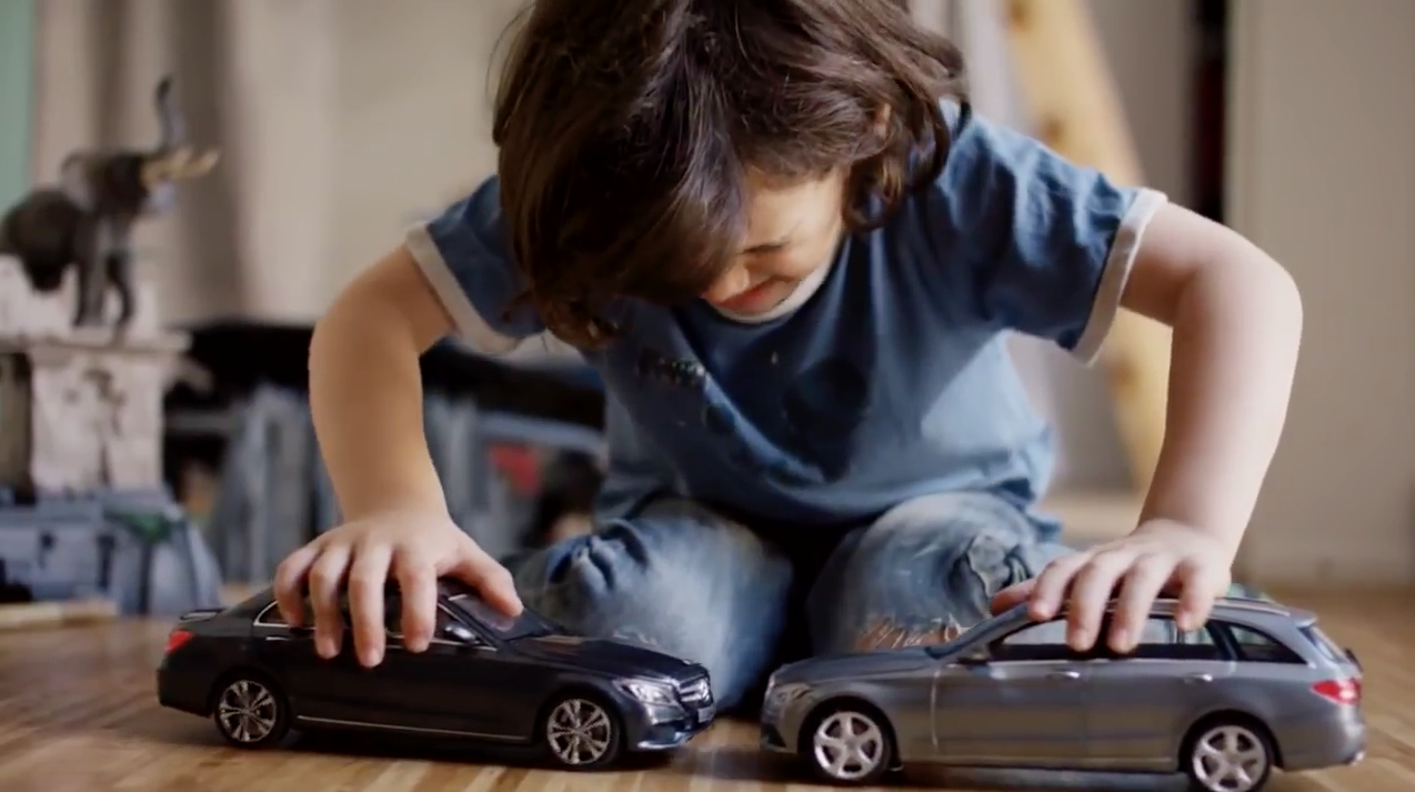 Little Kid Playing With Cars