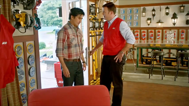 Two men stand in an Ace Hardware store.