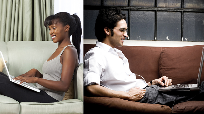 Black woman on laptop on the left and white man on his laptop on the right.