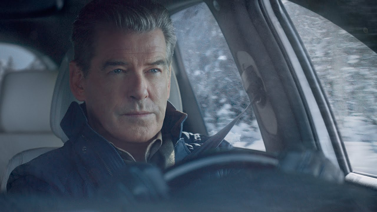pierce brosnan drives a whole different kind of getaway car in kias super bowl ad adweek