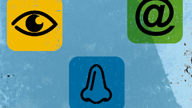 IPhone with fake icons of a green at sign, yellow eye, blue nose, white and green dollar sign and red tongue.